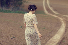 Girl on the road in  field Stock Image