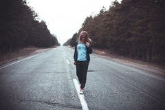 Girl on a road Royalty Free Stock Photos