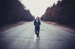 Girl on a road Stock Photography