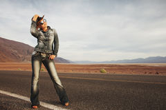 Girl on road Stock Images