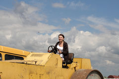 Girl on road-roller Royalty Free Stock Images