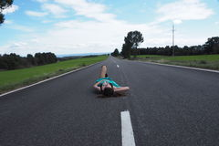Girl on the road. Session with alone road Stock Image