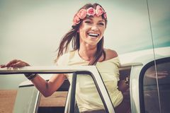 Girl on a road trip. Hippie girl in a van on a road trip royalty free stock photography