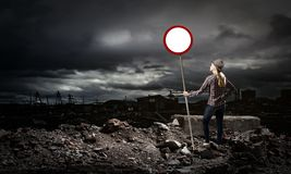 Girl with roadsign Stock Photos