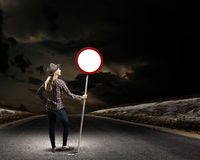 Girl with roadsign Stock Photo