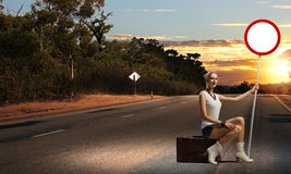 Girl with roadsign Stock Image