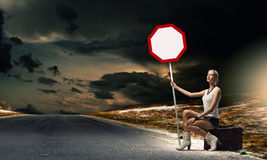 Girl with roadsign Stock Photography