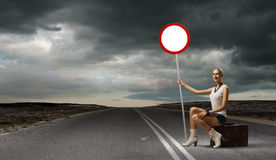 Girl with roadsign Royalty Free Stock Photos