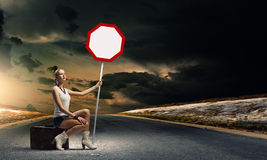 Girl with roadsign Royalty Free Stock Photography
