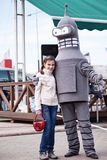 Girl with a robot Bender. Stock Images