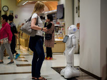 Girl and Robot. A blonde girl and a robot in Japan Royalty Free Stock Images
