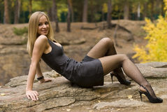 Girl on a rock. Cute young girl on a rock outdoor portrait stock images