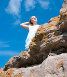 The girl on a rock Royalty Free Stock Image