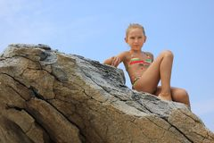 Girl on the rock Stock Photography