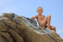 Girl on the rock. Sweet girl on the rock stock photography