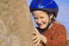 Girl on the rock. Girl climbing up the rock Royalty Free Stock Photos