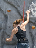 Girl rock climbing Stock Photos