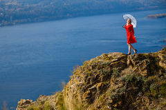 Girl on the rock stock photo