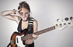 Girl on rock guitar Stock Image