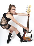Girl on rock guitar Royalty Free Stock Image