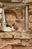Girl in a rock house. Royalty Free Stock Photography