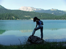 Girl on a rock near a glacier lake at Durmitor Stock Photos