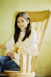 Girl in rocking chair Stock Images