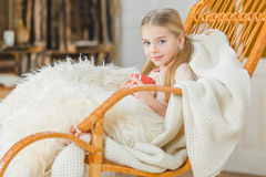 Girl in rocking chair Stock Photos