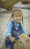 Girl on Rocking Horse in Playground Royalty Free Stock Images