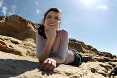 Girl on the rocks Stock Images