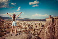 Girl with rocks formations in Turkey. Girl standing on background of rocks formations of Cappadocia in Central Anatolia, Turkey stock photography