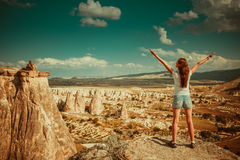 Girl with rocks formations in Turkey. Girl standing on background of rocks formations of Cappadocia in Central Anatolia, Turkey royalty free stock photos