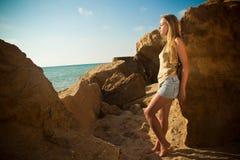 Girl among the rocks on the nature Stock Photo