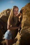 Girl among the rocks on the nature Royalty Free Stock Image