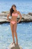 Girl on rocky seashore Royalty Free Stock Image