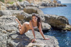 Girl on rocky seashore Royalty Free Stock Images