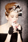 Girl with Rococo hair style and cake g Royalty Free Stock Image