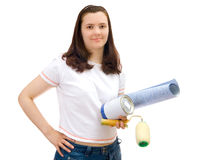 Girl with roller (platen) and paint, isolated. Girl in coverall painting wall by roller (platen) isolated over white Royalty Free Stock Images