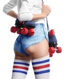 Girl with a roller skate on the shoulder Royalty Free Stock Image