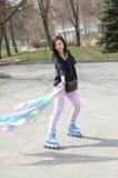 Girl in roller skate in the street. Stock Photo