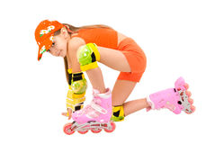 The girl on roller skates. The girl in an orange suit on pink roller skates Stock Photography