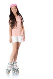Girl on roller skates. Beautiful dark-haired girl wearing a pink sweater and short white shorts touches on roller skates - Isolated on white background Royalty Free Stock Images