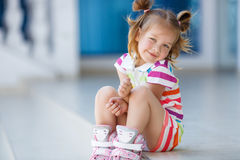 A girl roller-skates in the city Stock Images