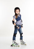 Girl in roller skates isolated on white background Royalty Free Stock Photos