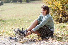 Girl with roller skates. Royalty Free Stock Photos