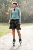 Girl with roller skates. Stock Photo