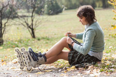Girl with roller skates. Stock Image