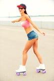 Girl roller skating. Stock Photos