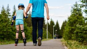 Girl roller-skating with my dad Royalty Free Stock Images