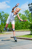 Girl roller-skating in the park Stock Photography